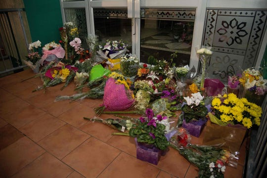 Flowers are placed on the front steps of the Wellington Masjid mosque in Kilbirnie in Wellington on March 15, 2019, after a shooting incident at two mosques in Christchurch.