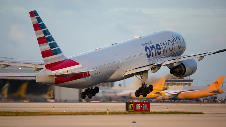 An American Airlines Boeing 777 takes off from Miami International Airport on Feb. 23, 2019.