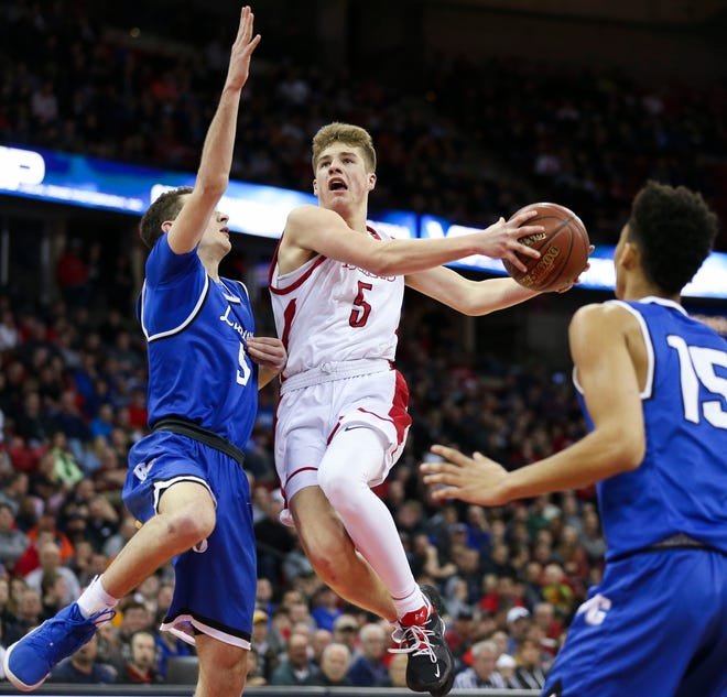 Neenah's Max Klesmit (5) drives to the basket against Brookfield Central during a WIAA Division 1 boys basketball state semifinal Friday at the Kohl Center in Madison.
