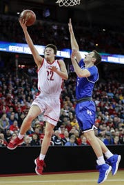 Neenah's Jacob Dietz (left) puts up a shot during Friday's WIAA Division 1 boys basketball state semifinal game against Brookfield Central at the Kohl Center in Madison.
