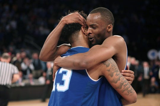 Seton Hall Pirates guard Myles Powell (13) celebrates with guard Quincy McKnight (0)