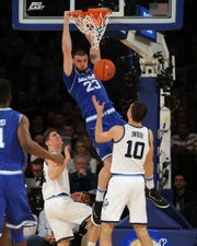 Seton Hall Pirates forward Sandro Mamukelashvili (23) dunks against Villanova Wildcats guard Collin Gillespie (2) and forward Cole Swider (10)