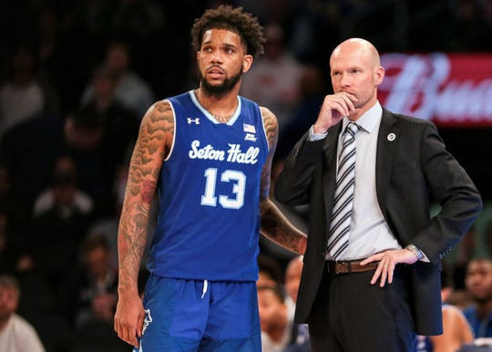 Seton Hall Pirates guard Myles Powell (13) talks with head coach Kevin Willard during the second half in the Big East conference tournament against the Marquette Golden Eagles