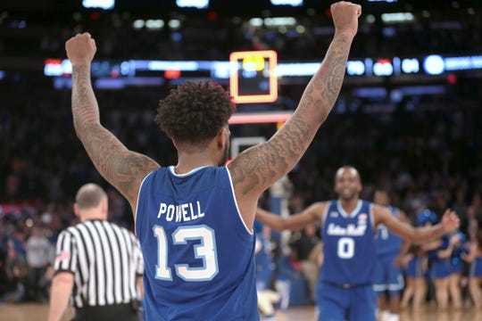 Seton Hall Pirates guard Myles Powell (13) celebrates with guard Quincy McKnight (0) during the second half in the Big East conference tournament against the Marquette Golden Eagles at Madison Square Garden.