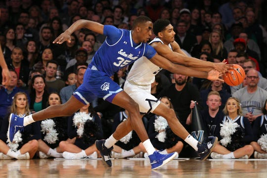 Seton Hall Pirates center Romaro Gill (35) and Villanova Wildcats forward Jermaine Samuels (23) chase a loose ball during the first half of the Big East conference tournament final
