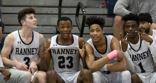 Ranney players celebrate on the bench as the clock ticks down on their win. Ranney Boys Basketball vs Moorestown in a 2019 NJSIAA Tournament of Champions semifinals in Toms River on March 15, 2019.