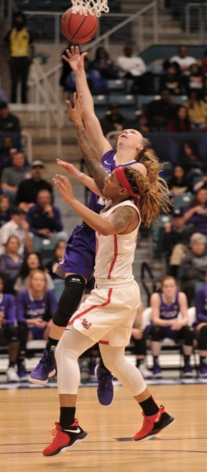 ACU's Breanna Wright, left, drives to basket as a Lamar player defends. ACU beat the Cardinals 88-79 in the Southland Conference Tournament semifinals Saturday at the Merrell Center in Katy.
