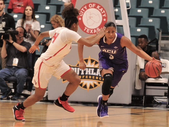 ACU's Dominique Golightly, right, brings the ball up court as Lamar's Briana Laidler defends.