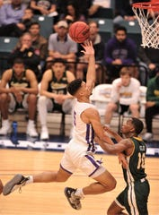 ACU's Payten Ricks, left, sails to the basket as Southeastern Louisiana's Von Julien defends in the first half. Ricks scored 14 of his game-high 21 points in the half.