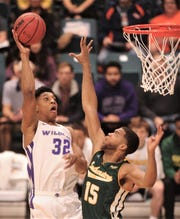 ACU's Joe Pleasant (32) shoots over Southeastern Louisiana's Maxewell Starwood. The Wildcats beat Southeastern Louisiana 69-66 in the Southland Conference Tournament semifinals March 15 at the Merrell Center in Katy. Pleasant is one of seven returning players for the Wildcats this season.
