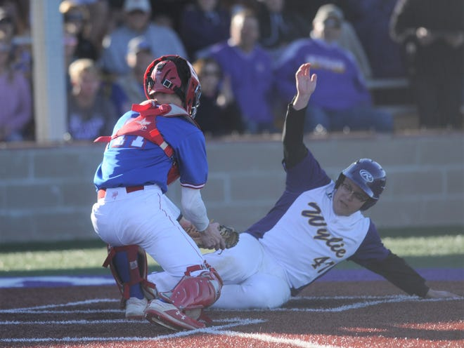 Wylie's Alex Guzman slides safely into home to beat the tag from Cooper catcher Jacob Hummel in a District 4-5A baseball game Friday at Bulldog Field.