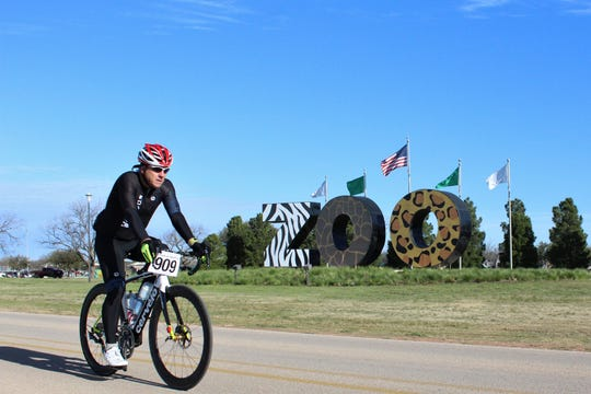 Richard Cobb (909) warms up against a chilly breeze Saturday morning before participating in the Steam N Wheels bike ride that departed Nelson Park.