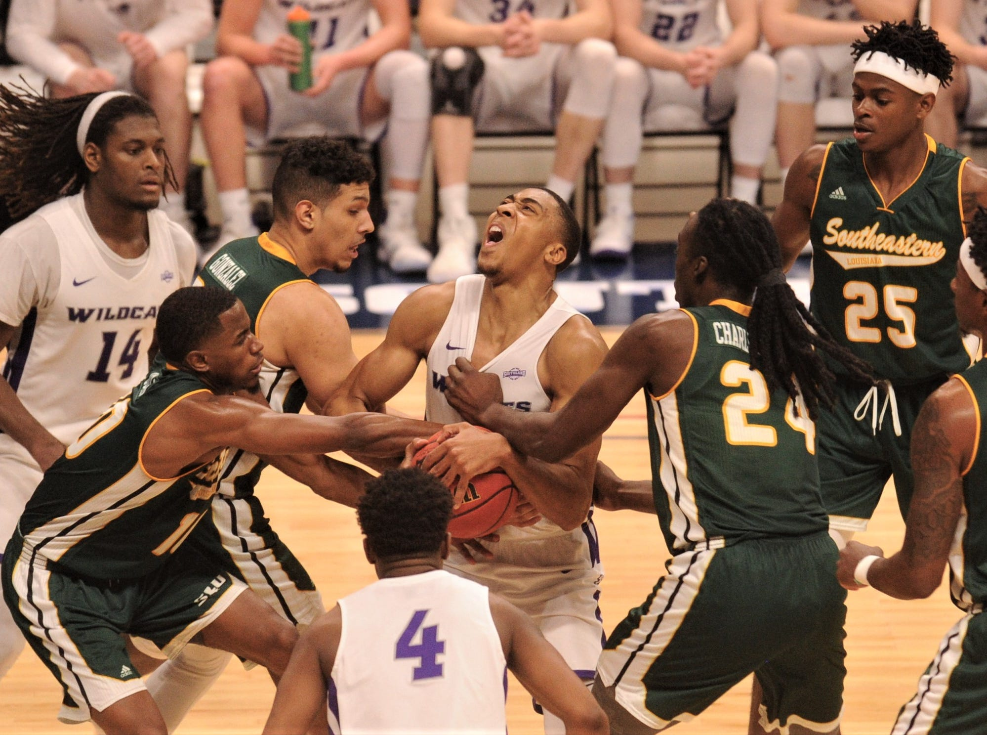 ACU's Jaylen Franklin, center, battles the Southeastern Louisiana defense for an offensive rebound. Franklin came down with the ball and was fouled on the play in the second half. The Wildcats beat Southeastern Louisiana 69-66 in the Southland Conference Tournament semifinals Friday, March 15, 2019, at the Merrell Center in Katy.