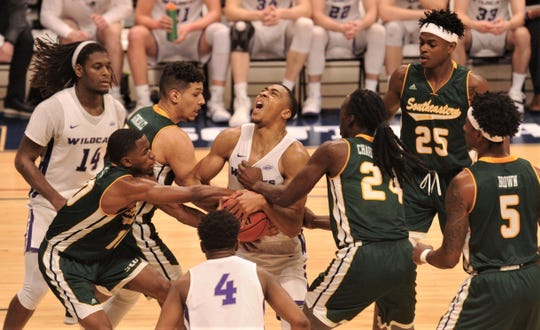 ACU's Jaylen Franklin, center, battles the Southeastern Louisiana defense for an offensive rebound. Franklin came down with the ball and was fouled on the play in the second half.