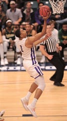 ACU's Jaren Lewis drives to the basket in the first half against Southeastern Louisiana.