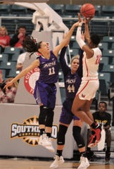 ACU's Sara Williamson, left, defends as Lamar's Miya Crump shoots in the second half.