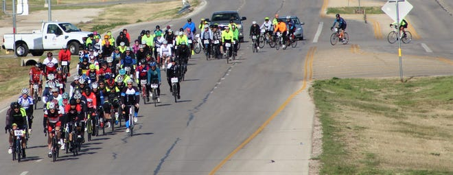 Bicyclists turn onto E.S. 11th Street from Nelson Park to begin the annual Steam N Wheels ride Saturday. A total of 161 registered.