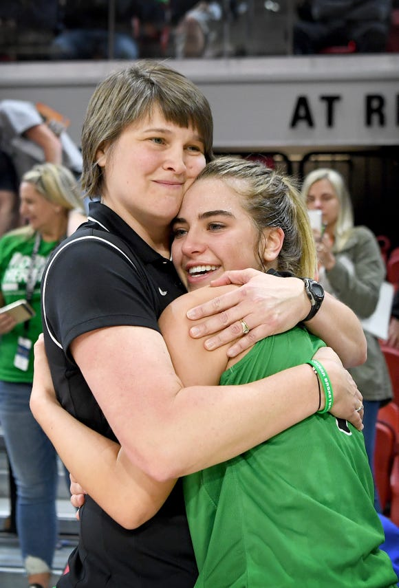 Mountain Heritage coach Susie Shelton and Hannah Tipton celebrate after the NCHSAA 2A state championship game at N.C State's Reynolds Coliseum on March 16, 2019. The Lady Cougars ended their perfect season as state champions with a 63-53 win.