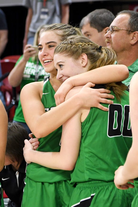Mountain Heritage's Hannah Tipton and Presley Peterson celebrate after the NCHSAA 2A state championship game at N.C State's Reynolds Coliseum on March 16, 2019. The Lady Cougars ended their perfect season as state champions with a 63-53 win.