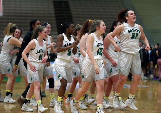 Seton Catholic players celebrate their 59-57 victory over Sewanhaka in the girls Class A state semifinal at Hudson Valley Community College in Troy March 16, 2019.