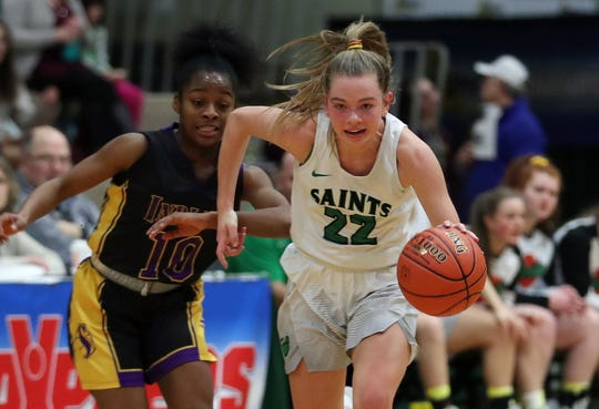 Seton Catholic's Reese Vaughn (22) drives to the basket against Sewanhaka during the girls Class A state semifinal at Hudson Valley Community College in Troy March 16, 2019. Seton Catholic won the game 59-57.
