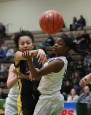 Seton Catholic's Marasia Dyes (5) and  Sewanhaka's Nia Lazo (2) battle for a loose ball during the girls Class A state semifinal at Hudson Valley Community College in Troy March 16, 2019. Seton Catholic won the game 59-57.