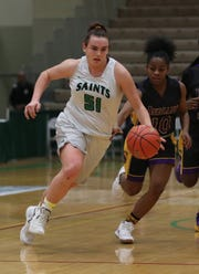 Seton Catholic's Julia Hauer (51) drives to the basket against Sewanhaka during the girls Class A state semifinal at Hudson Valley Community College in Troy March 16, 2019. Seton Catholic won the game 59-57.