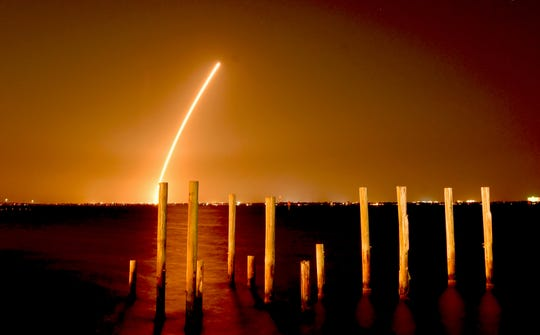 A time exposure of the Delta IV launch from Cape Canaveral Air Force Station, as seen from the edge of Indian River Lagoon, just north of the Melbourne Causeway.