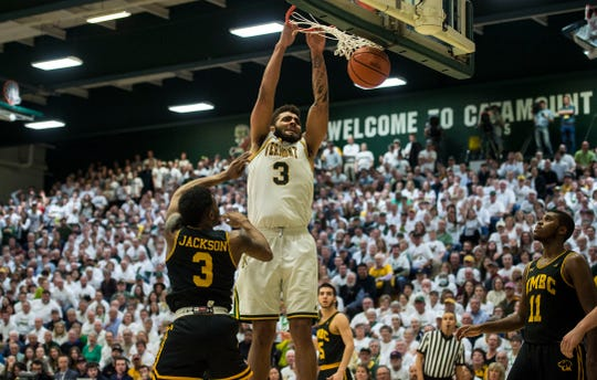 UVM Men's basketball #3 Anthony Lamb hammers the slam dunk down over UMBC #3 K.J. Jackson during the America East Championship in Burlington, Vt., on Saturday, March 16, 2019. UVM won, 66-49 and will head to the NCAA March Madness Tournament.