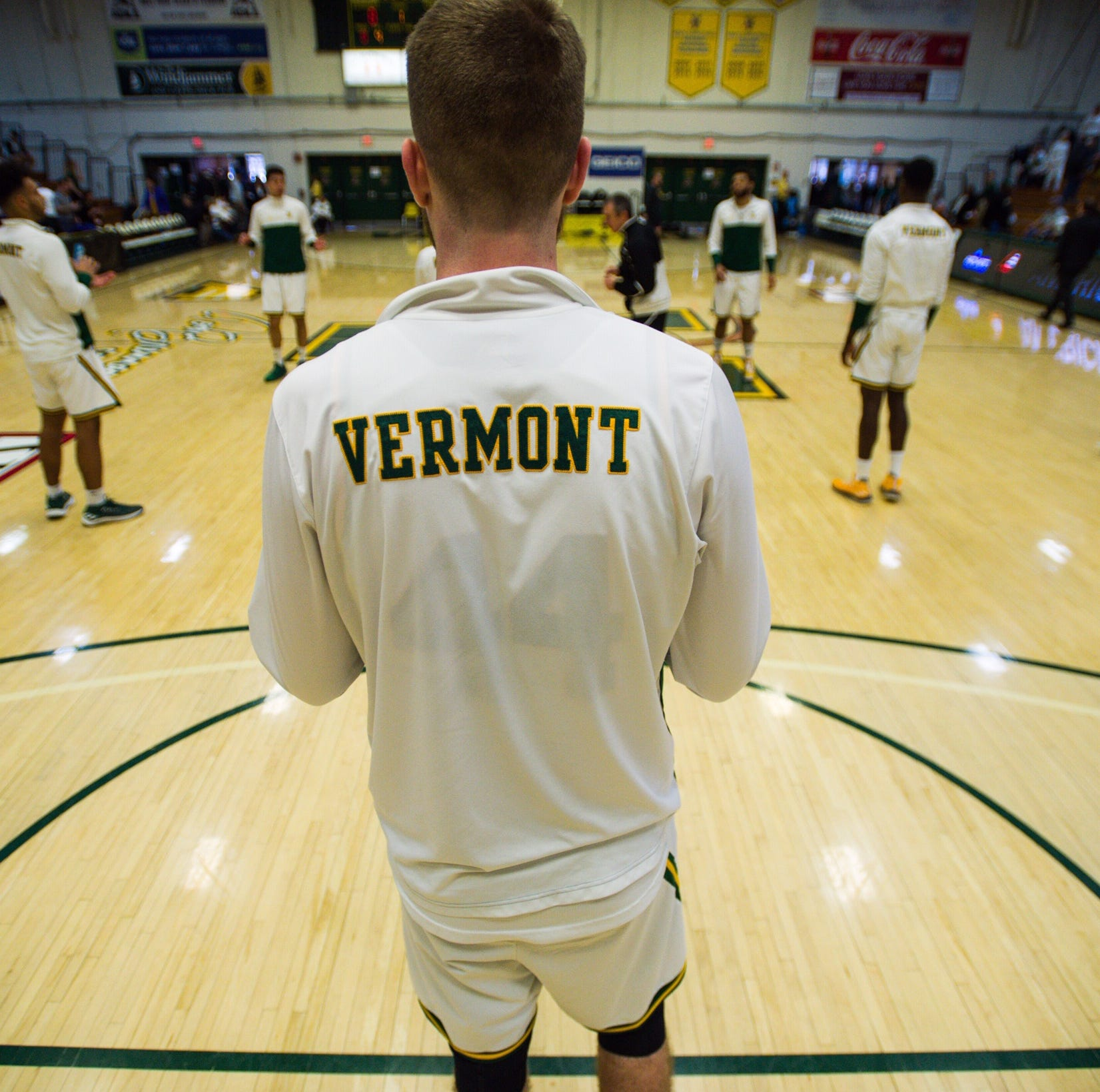 The University of Vermont men's basketball team warms up before the 2019 America East Championship game against UMBC at Patrick Gym on Saturday, March 16.