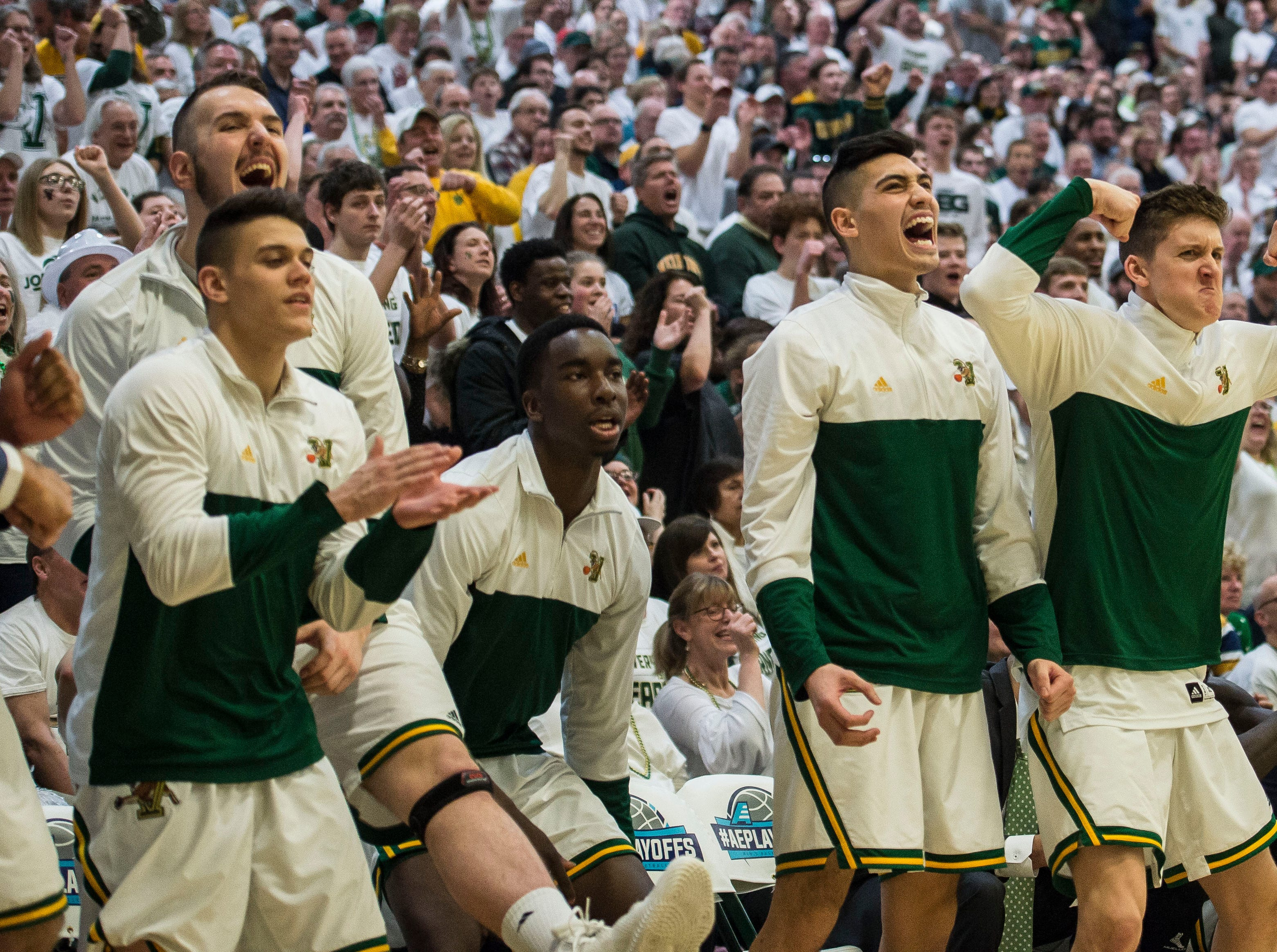 The UVM men's basketball team reacts to a 3-point shot from Ben Shungu during the America East Championship in Burlington, Vt., on Saturday, March 16, 2019. UVM won, 66-49 and will head to the NCAA March Madness Tournament.