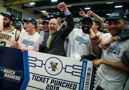 UVM men's basketball Head Coach John Becker celebrates with his team after winning the America East Championship in Burlington, Vt., on Saturday, March 16, 2019. UVM won 66-49 and will head to the NCAA March Madness Tournament.