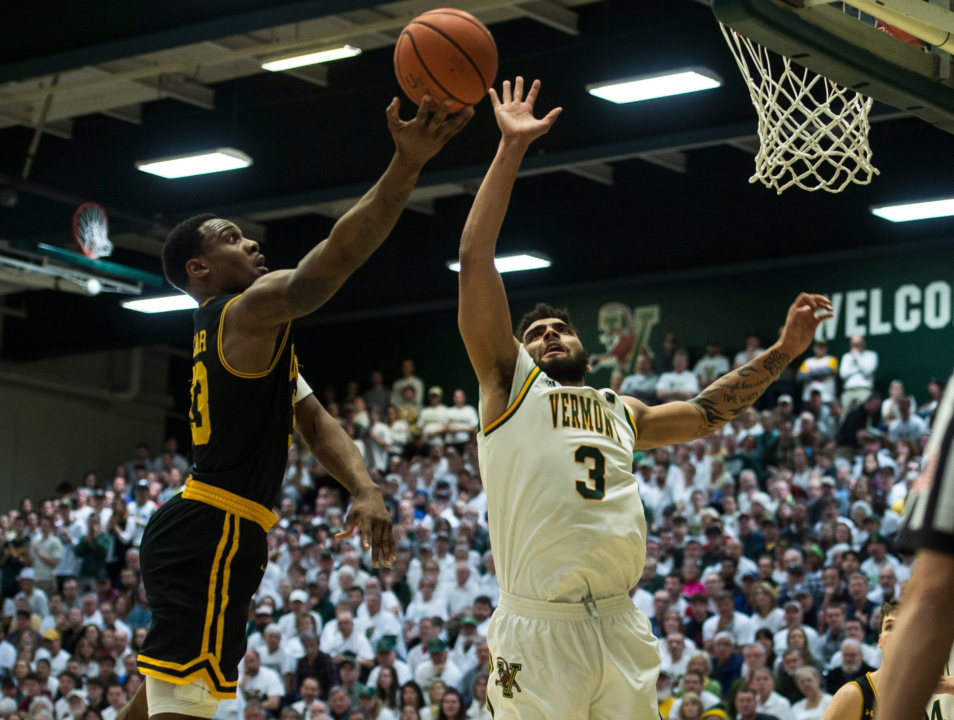 UVM Men's basketball #3 Anthony Lamb denies UMBC #33 Arkel Lamar during the America East Championship in Burlington, Vt., on Saturday, March 16, 2019. UVM won, 66-49 and will head to the NCAA March Madness Tournament.