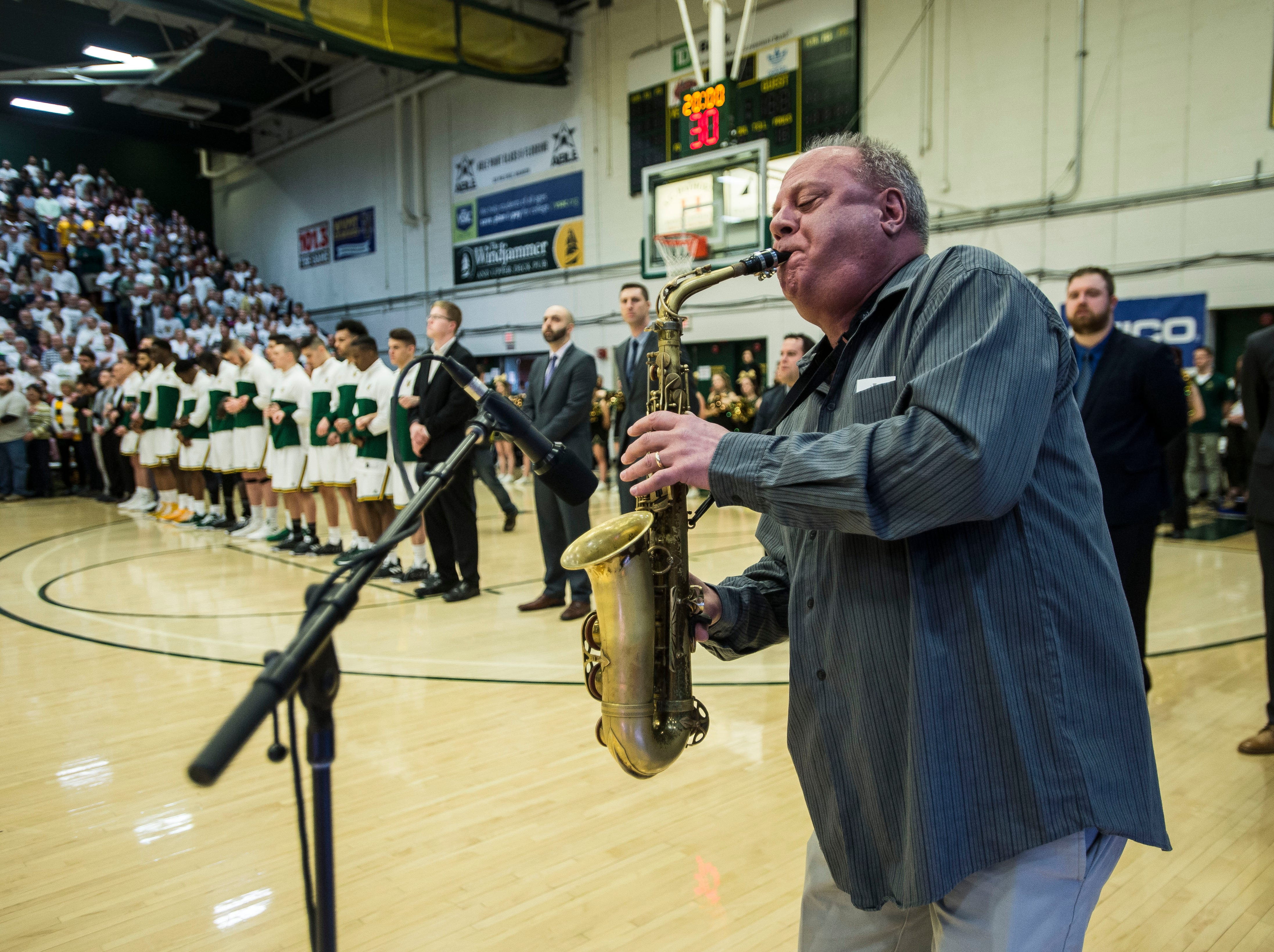 Dave Grippo plays the National Anthem before the start of the America East Championship in Burlington, Vt., on Saturday, March 16, 2019. UVM won, 66-49 and will head to the NCAA March Madness Tournament.