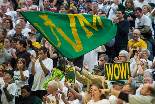 UVM fans react to a series of 3-point shots from Anthony Lamb during the America East Championship in Burlington, Vt., on Saturday, March 16, 2019. UVM won, 66-49 and will head to the NCAA March Madness Tournament.