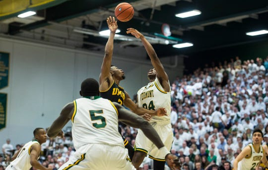 UVM Men's basketball #24 Ben Shungu challenges UMBC #3 K.J. Jackson during the America East Championship in Burlington, Vt., on Saturday, March 16, 2019. UVM won, 66-49 and will head to the NCAA March Madness Tournament.