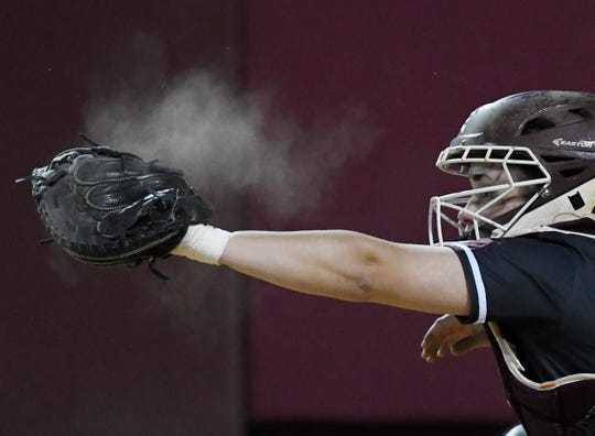 Flour Bluff's Madi Hale catches the ball at a game against Tuloso Midway, Friday, March 15, 2019.