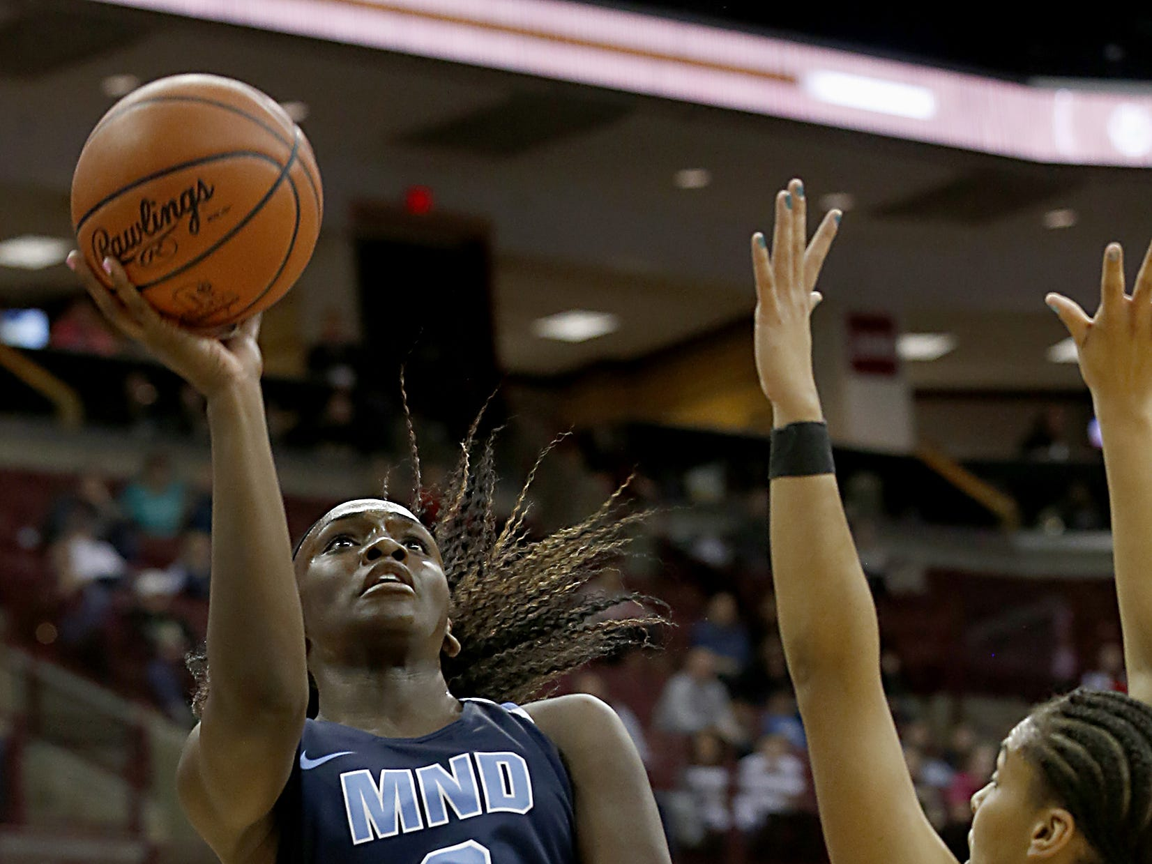 Mount Notre Dame guard K.K. Bransford adds two against GlenOak during their Division I semifinal game in the 44th Annual State Girls Basketball Tournament at the Schottenstein Center in Columbus Friday, March 15, 2019.