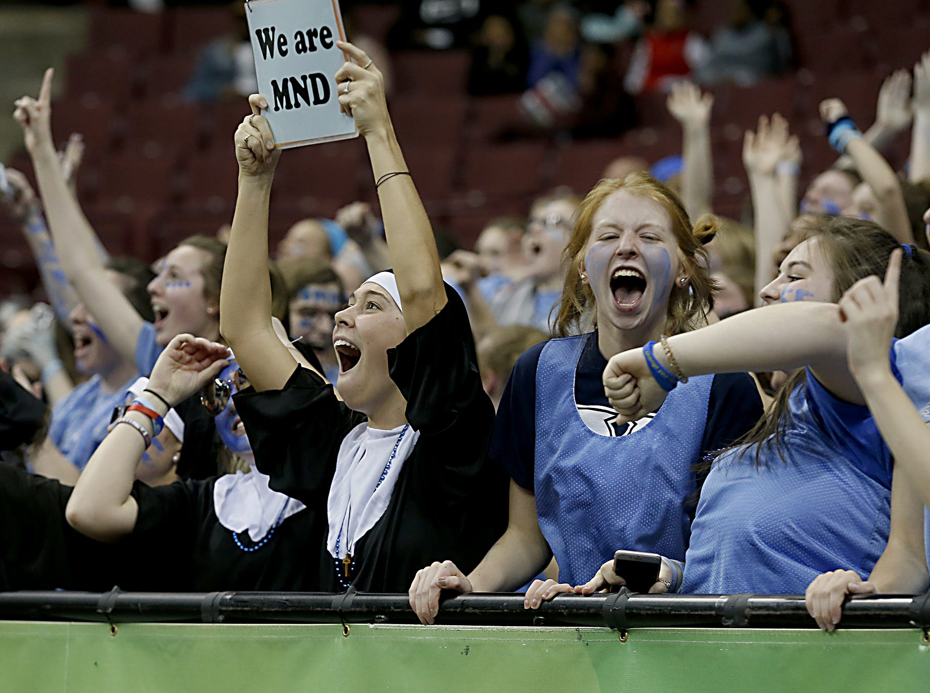 The Mount Notre Dame student section reacts as their school defeats GlenOak in their Division I semifinal game in the 44th Annual State Girls Basketball Tournament at the Schottenstein Center in Columbus Friday, March 15, 2019.