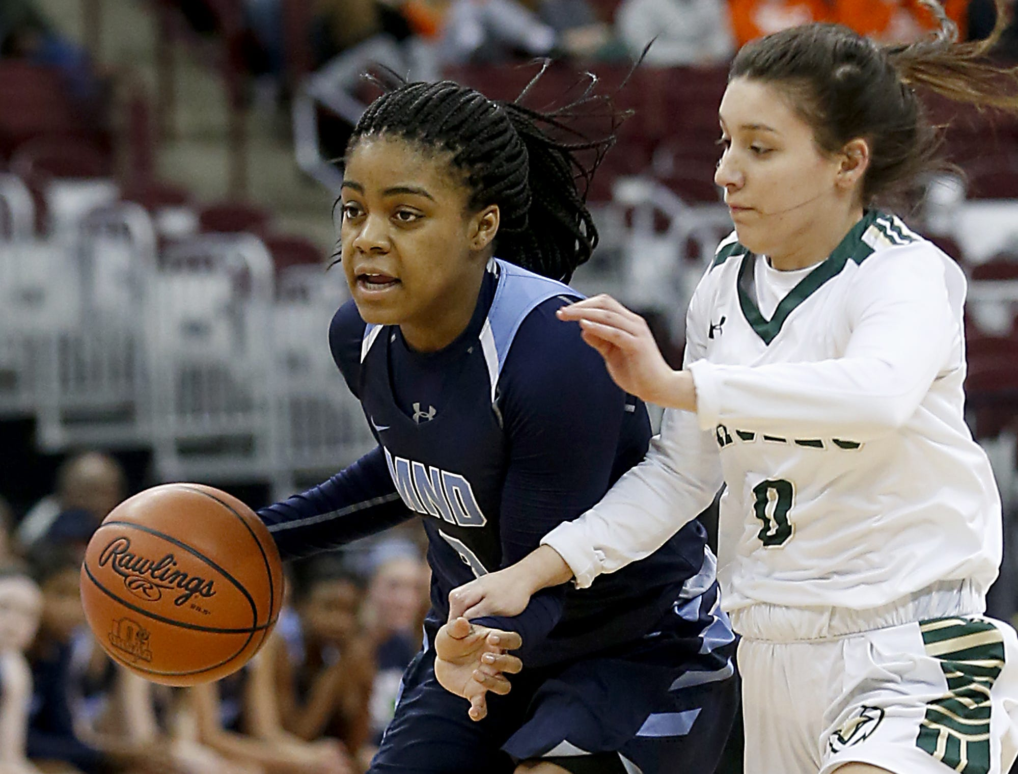 Mount Notre Dame guard Makira Cook is covered by GlenOak guard Addison Mucci during their Division I semifinal game in the 44th Annual State Girls Basketball Tournament at the Schottenstein Center in Columbus Friday, March 15, 2019.