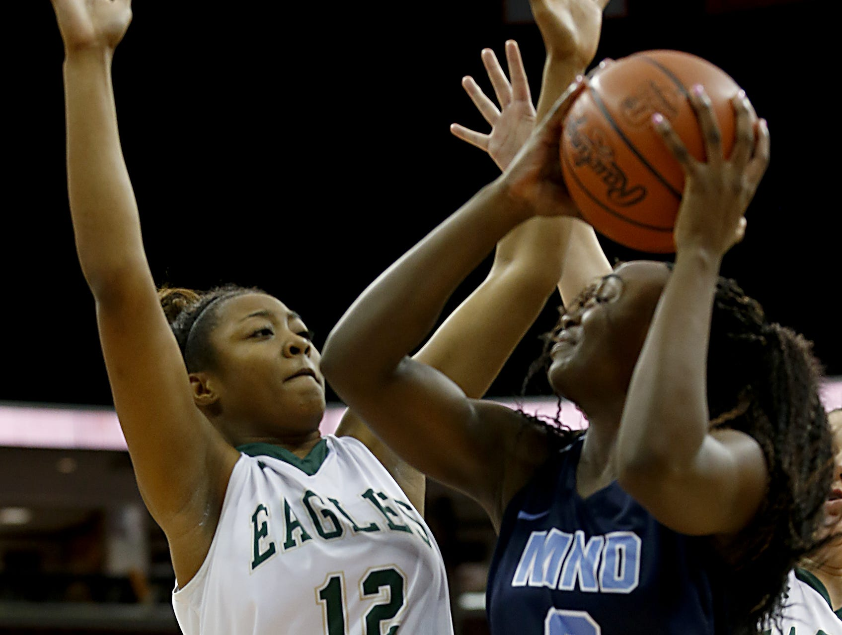 Mount Notre Dame guard K.K. Bransford draws a shooting foul from GlenOak forward Aniyah Hall during their Division I semifinal game in the 44th Annual State Girls Basketball Tournament at the Schottenstein Center in Columbus Friday, March 15, 2019.