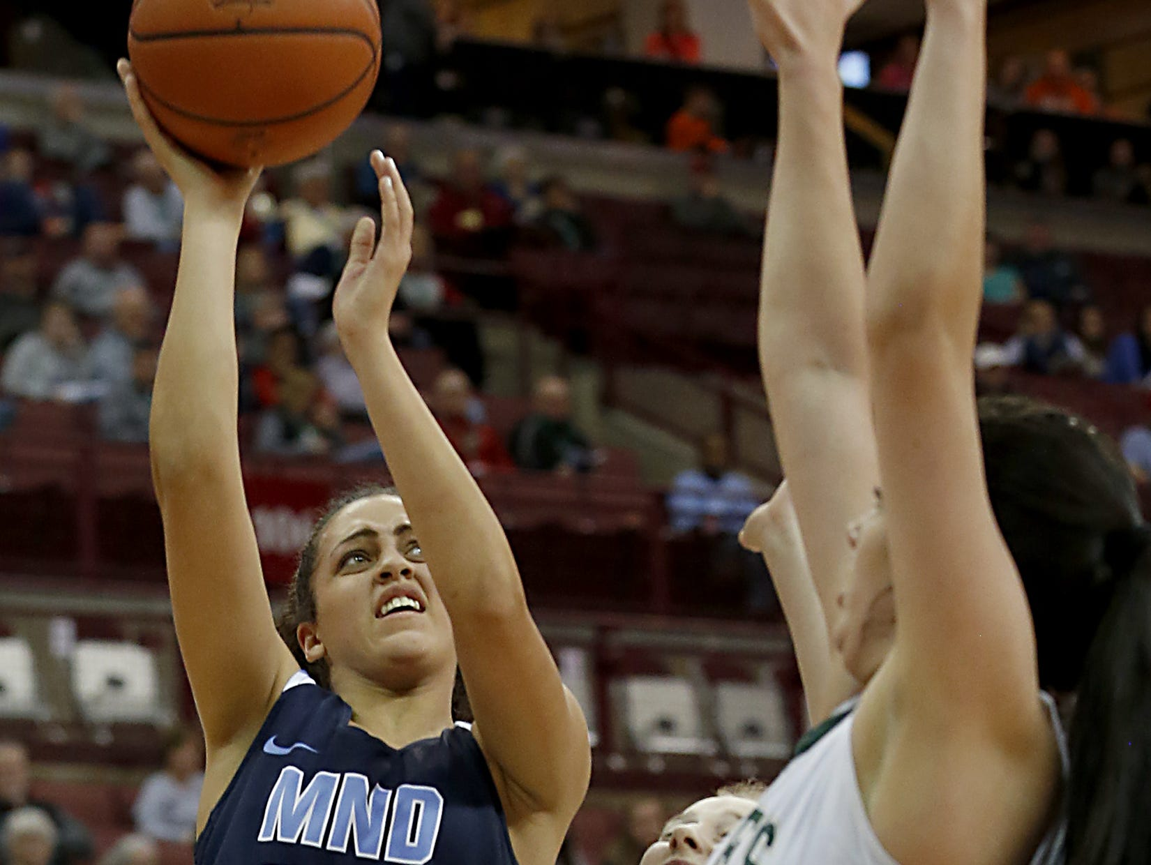 Mount Notre Dame guard Gabbie Marshall scores against GlenOak during their Division I semifinal game in the 44th Annual State Girls Basketball Tournament at the Schottenstein Center in Columbus Friday, March 15, 2019.