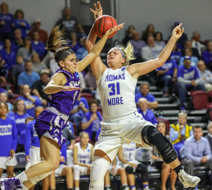 Thomas More's Emily Schultz competes for a rebound against Scranton's Emily Sheehan in the Division III women's final four on Friday at the Roanoke College Cregger Center in Salem, Virginia.