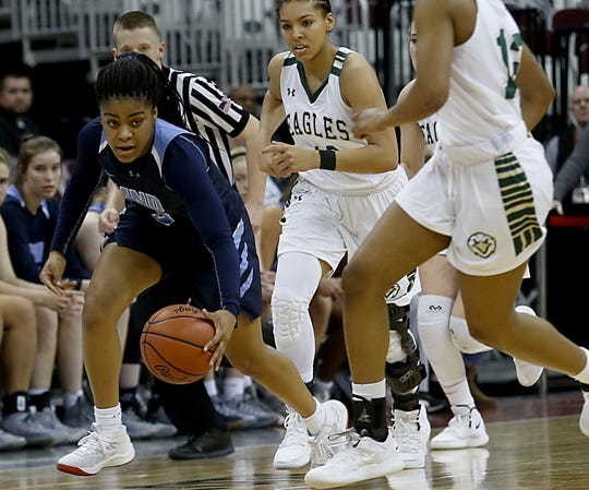 Mount Notre Dame guard Makira Cook scoops up a loose ball against GlenOak during their Division I semifinal game in the 44th Annual State Girls Basketball Tournament at the Schottenstein Center in Columbus Friday, March 15, 2019.