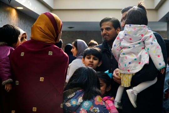 The Pabaney and Zaidi families mingle after the vigil at the Islamic Center of Greater Cincinnati, March 16, 2019. After the mosque shootings in Christchurch, Asma Zaidi has become concerned for the safety of her family.