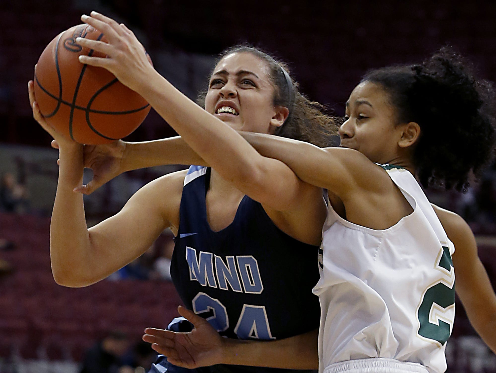 Mount Notre Dame guard Gabbie Marshall is fouled by GlenOak guard Brielle Williams during their Division I semifinal game in the 44th Annual State Girls Basketball Tournament at the Schottenstein Center in Columbus Friday, March 15, 2019.