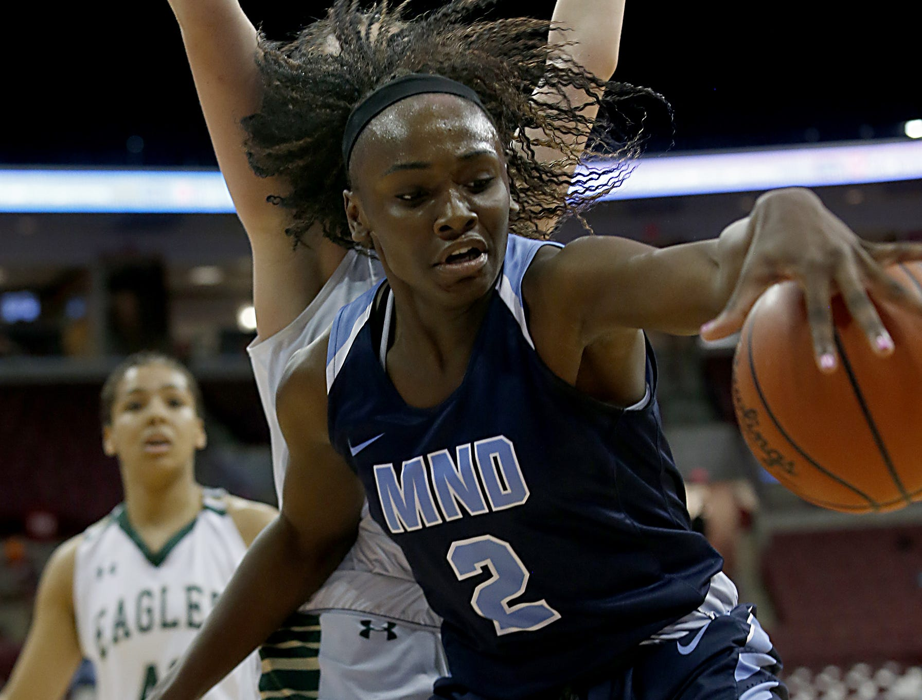 Mount Notre Dame guard K.K. Bransford keeps the ball in play against GlenOak during their Division I semifinal game in the 44th Annual State Girls Basketball Tournament at the Schottenstein Center in Columbus Friday, March 15, 2019.