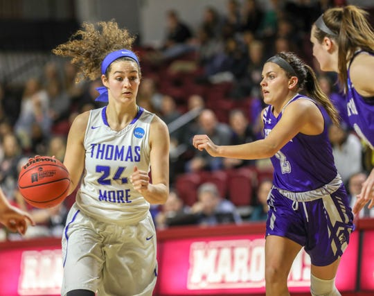 Thomas More's Madison Temple looks to drive past Scranton's Emily Sheehan.