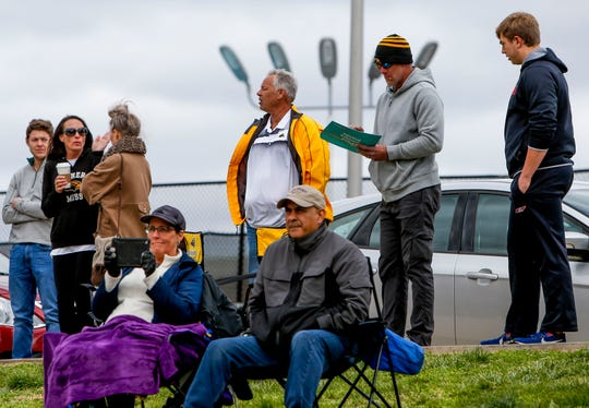 Spectators, including retired NFL quarterback Brett Favre doing a signature for a friend, watch the ongoing game between Central Arkansas and Southern Miss at Winfield Dunn Center lawn in Clarksville, Tenn., on Friday, March 15, 2019.