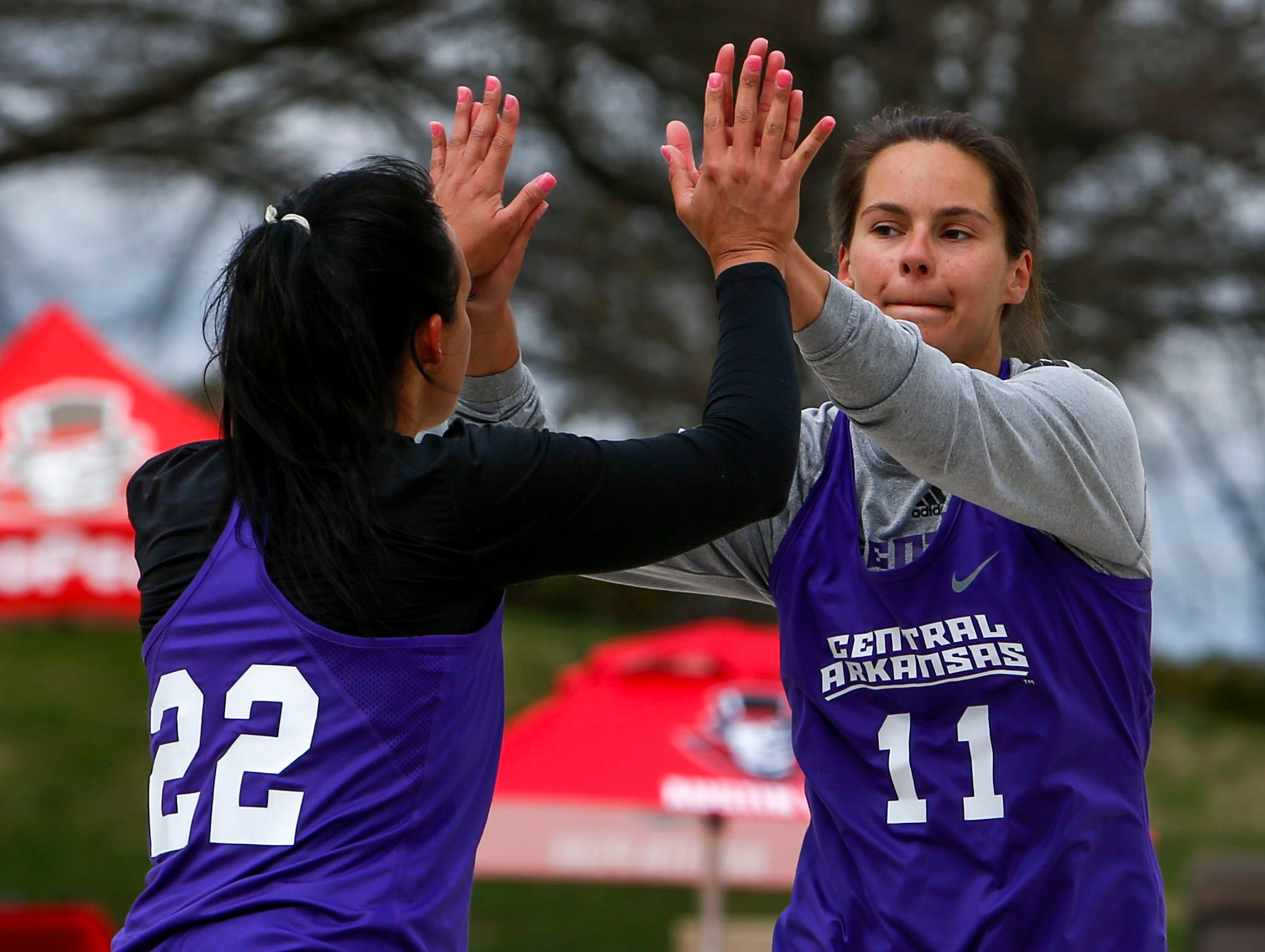 Central Arkansas players high five after scoring a point at Winfield Dunn Center lawn in Clarksville, Tenn., on Friday, March 15, 2019.